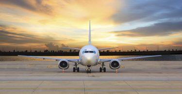 passenger jet plane parking on airport runways use for business transport and cargo logistic background